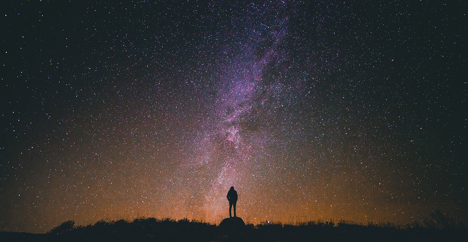 Photo of a person silhouetted against the night sky